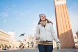 Portrait of happy young woman on Piazza San Marco, Venice