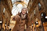 Woman in Galleria Vittorio Emanuele II showing thumbs up
