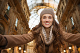 Happy woman taking selfie in Galleria Vittorio Emanuele II