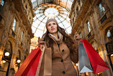 Woman with shopping bags in Galleria Vittorio Emanuele II