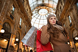 Young woman with shopping bags in Galleria Vittorio Emanuele II