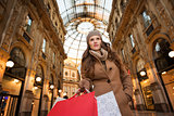 Vogue woman with shopping bags in Galleria Vittorio Emanuele II