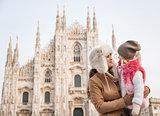 Mother and daughter near Duomo spending time sightseeing Milan