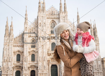 Portrait of mother and daughter in front of Duomo in Milan