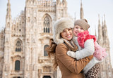 Portrait of happy mother and daughter near Duomo in Milan