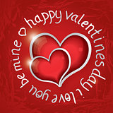 Valentines day round lettering with two red hearts.