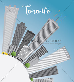 Toronto skyline with grey buildings, blue sky and copy space.