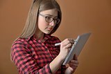 teen girl using tablet computer