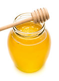 Natural honey in a glass jar, spoon for honey