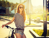 Trendy Hipster Girl with Bike in the City