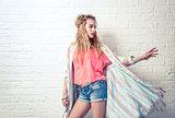 Boho Fashion Girl at White Brick Wall Background