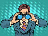 Businessman looking through binoculars. Lead vision Navigator