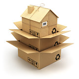 Moving house.  Cardboard box as home isolated on white. Real est