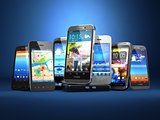 Choose mobile phone. Row of the different smartphones on blue ba