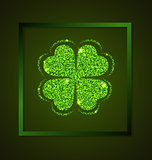 Four-leaf clover on a green background