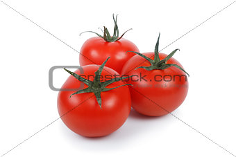 Three tomatoes over white.
