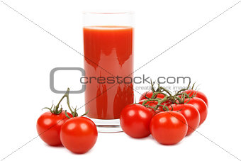 Tomato juice and bunch of tomatoes over white.