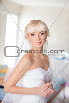 Blonde bride in white dress