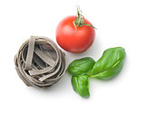 tagliatelle pasta with tomato and basil leaf