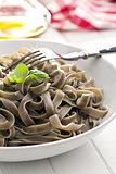 cooked black tagliatelle pasta