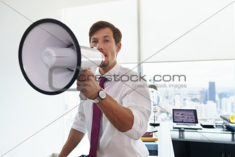 Business Man With Megaphone Doing Announcement In Office