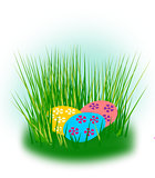 Easter eggs hidden in the grass.