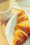 Continental Breakfast Croissant and Cup Of Coffee