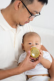 Father bottle feed baby