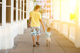 Father and child walking holding hands