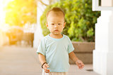 Asian toddler walking at outdoor