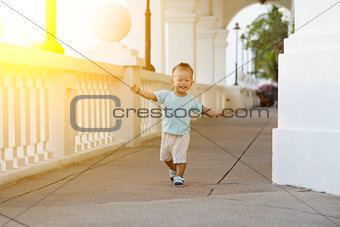 Asian toddler running at outdoor