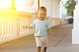 Asian baby boy running at outdoor