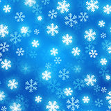 Blue blurred background with glowing snowflakes