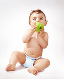 Baby boy eating apple