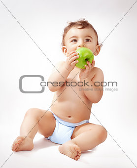 Baby boy eating apple