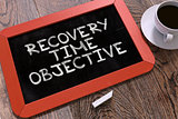Recovery Time Objective Handwritten by white Chalk on a Blackboard.