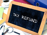 Tax Refund Concept Hand Drawn on Chalkboard.