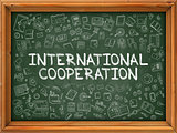 Hand Drawn International Cooperation on Green Chalkboard.