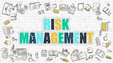 Risk Management on White Brick Wall.
