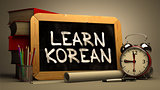 Learn Korean Handwritten on Chalkboard.