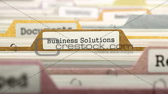 Business Solutions Concept on File Label.