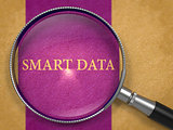 Smart Data through Lens on Old Paper.