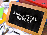Analytical Report Handwritten by White Chalk on a Blackboard.