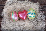 Easter eggs with  red heart symbol in natural nest