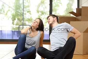 Tired couple moving home suffering