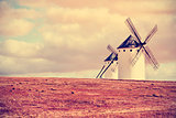 old windmills in Campo de Criptana, Spain, filtered