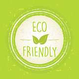 eco friendly with leaf sign in circle over green old paper backg