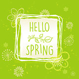 hello spring in frame with flowers over green old paper backgrou