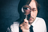 Businessman with magnifying glass, tax inspector doing financial