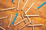 Scattered pencils on rustic wooden table